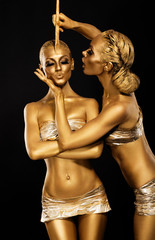 Fantasy. Creativity. Shiny Women's Gold Gilded Bodies. Arts