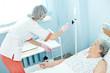 nurse preparing dropper for intravenous injection