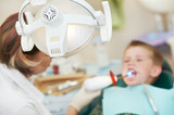 dental filing of child tooth by ultraviolet light poster