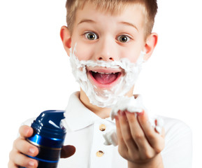 little boy in shaving foam. isolated