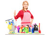 Woman posing with cleaning supplies and giving a thumb up