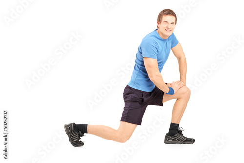 Young fit man exercising