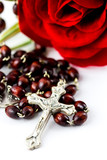 Rosary and rose
