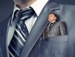 Small businessman in suit pocket