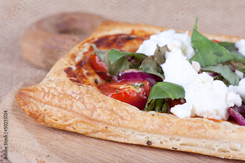 puff pastry with rocket close up
