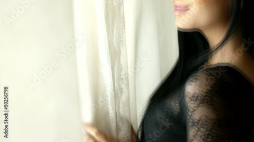 HD1080p Young sexy woman in black underwear on window
