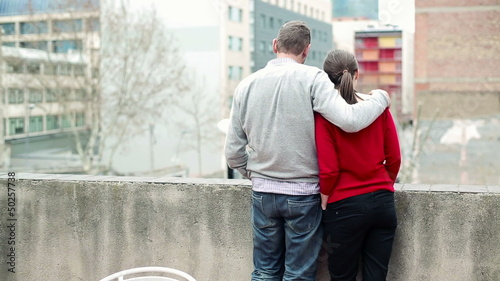 Couple in love standing on terrace