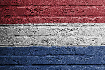 Brick wall with a painting of a flag, Holland