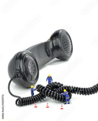 Leinwanddruck Bild Telephone engineers repairing a telephone line