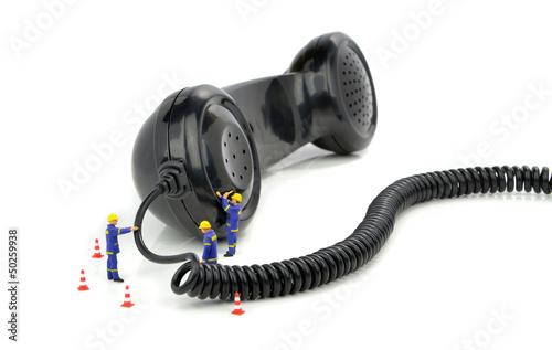Telephone engineers repairing a telephone receiver - 50259938