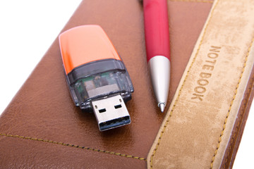 USB Flash Drive, pen and notebook