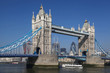 Tower Bridge with boat in London,  England