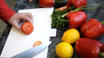 slicing tomato with a chef knife