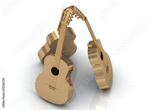 Three acoustic guitars made of gold