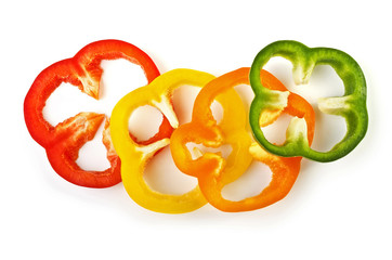 Sliced sweet colorful peppers isolated over white