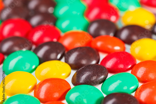 Multicolor bonbon sweets (ball candies) food background, closeup