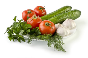 Summer still life consisting of vegetables isolated over white