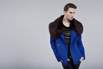 Handsome man dressed in spring fashion coat