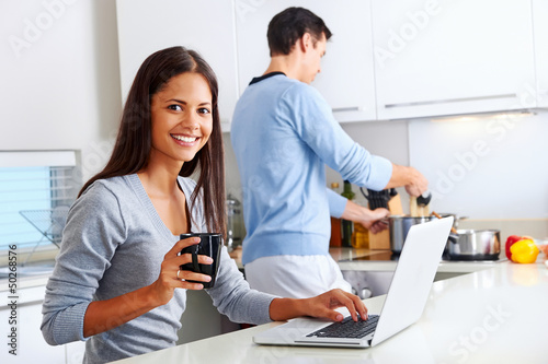laptop kitchen couple