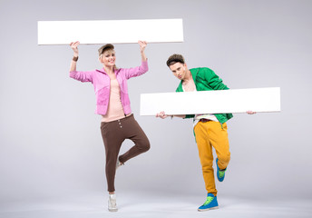Cheerful teenagers wearing colorful clothes