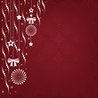 Christmas background of hanging ornaments with a copy space.