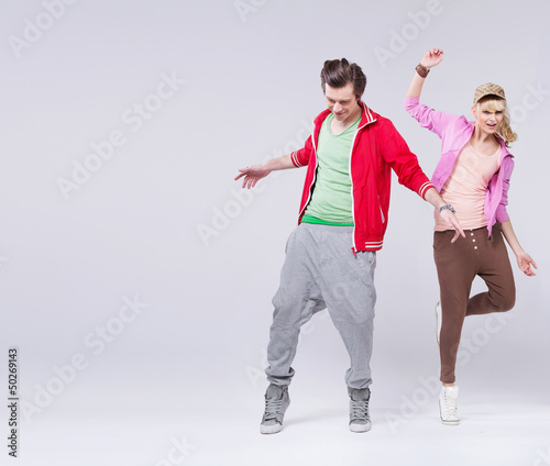 Relaxed couple of teenager in dance pose