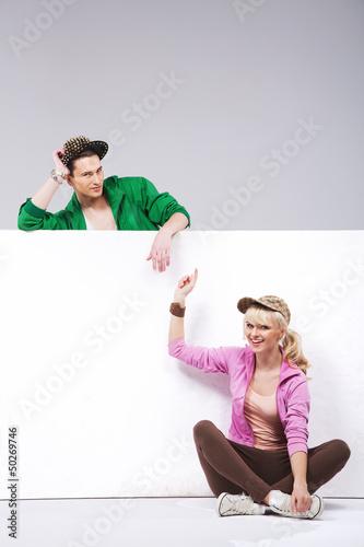 Happy teenage couple having fun