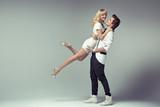 Proud stylish man hugging his beloved woman poster