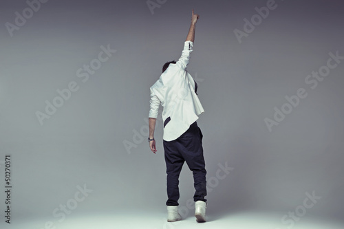 Victory gesture of a stylish guy