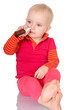 Little baby girl spraying herself nose spray isolated on white b