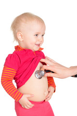 Sweet baby girl with phonendoscope isolated on a white backgroun