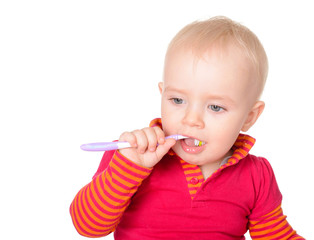Little baby girl with toothbrush isolated on white background
