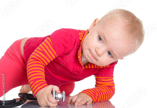 Cute baby girl with phonendoscope isolated on a white background
