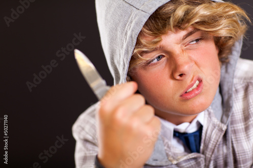 violent teen boy with knife