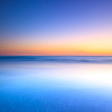 White beach and blue ocean on twilight sunset