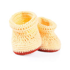 Handmade sweet baby booties isolated