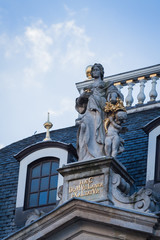 Statue on a roof in the Grand Place, Brussels