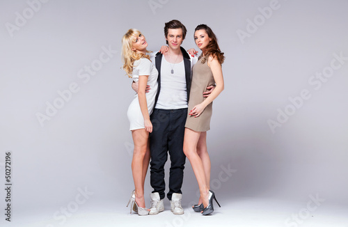 Relaxed man betweend two sexy girls