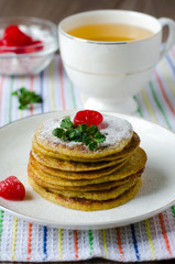 A stack of pancakes with cherry
