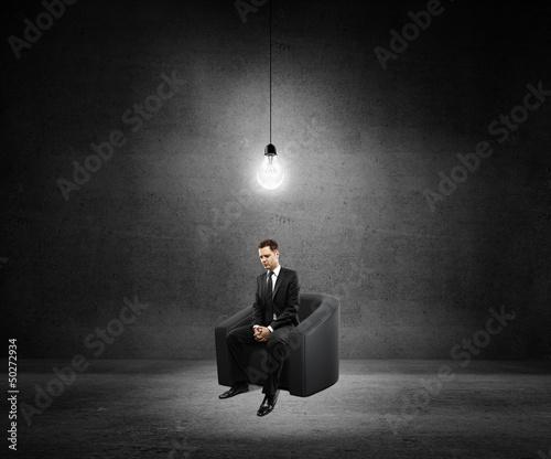 man sitting in sofa