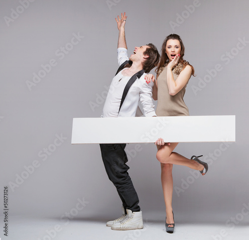 Screaming guy in funny pose with his girlfriend