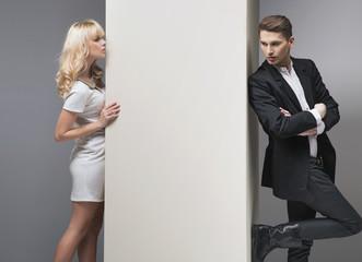 Alluring blonde woman trying to catch her boyfriend