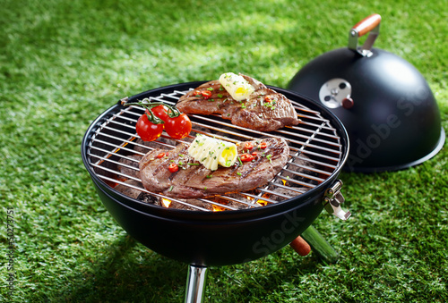Cooking steak on a barbecue