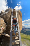 Dolomiti - hiker on wooden ladder