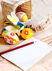 Easter bunny with eggs on rustic wooden planks