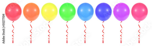 multicolored balloons tied with red ribbon