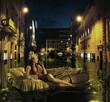 Stylish lady drifting among antique buildings