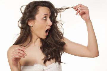 shocked girl because of her damaged hair