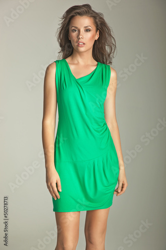 Dusky girl dressed in beautiful green dress