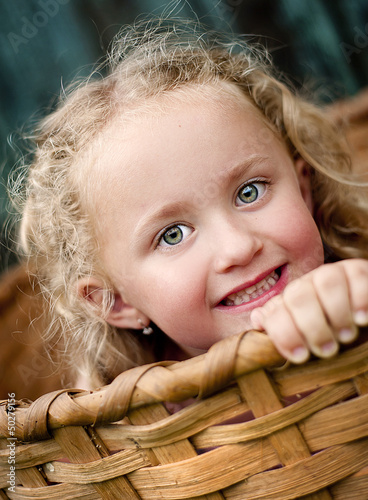 Little girl in the basket
